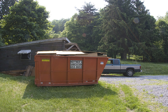 Roll-away dumpster